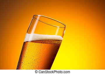 cold beer in a glass with dew drops - A german willi cup...