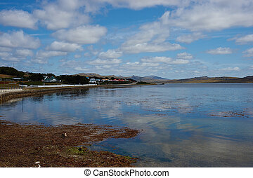 Stanley Harbour - Coastal road and path running along the...