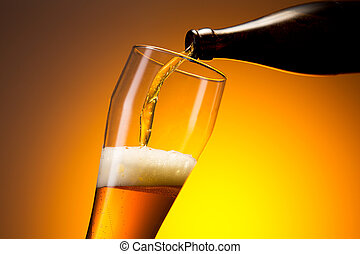 wheat beer pouring out of a bottle - Cold beer flows in to a...