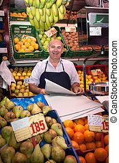 Friendly greengrocer - Smiling greengrocer at the market...