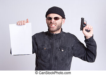 Bargaining terrorist - Dangerous looking man holding a gun...