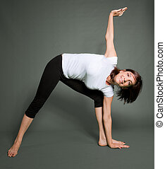 Yoga practice - A young woman in a yoga position