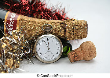 Counting down to the new year - A champagne bottle and a...