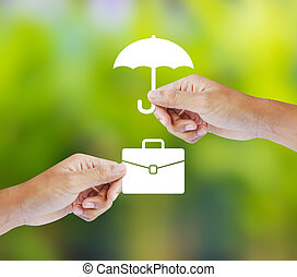 Business insurance concept with an umbrella covering...