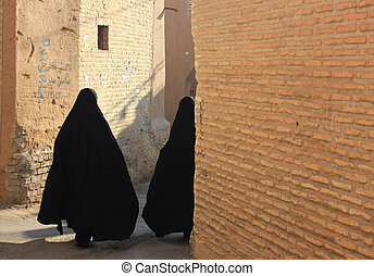 iranian women on the street - iranian women in black chador...