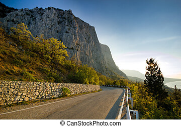 high rocks at sunrise, view from road - morning view from...