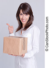 Satisfying delivery - Young woman holding a cardboard box...