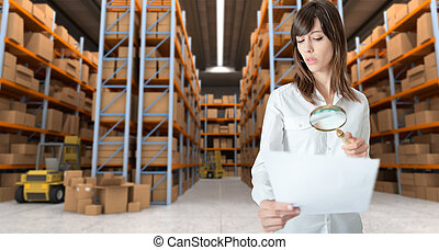 Woman inspecting document in wareho