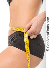 Weight loss - Woman measuring her thin waist