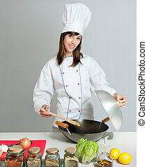 wok cooking lesson - Young chef in a neutral background...