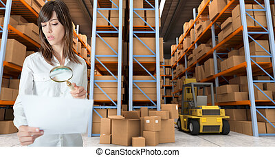 Woman verifying document in warehouse - Young woman...