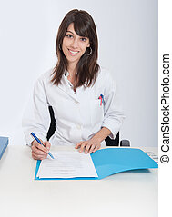 smiling healthcare professional with file