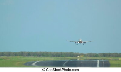 Landing - Jet airplane touch down the runway, super...