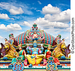 Oldest Hindu temple Sri Mariamman in Singapore over blue sky...
