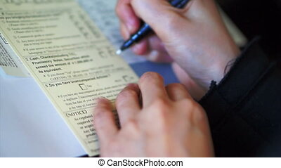 filling custom immigration form - Tourist hand filling...