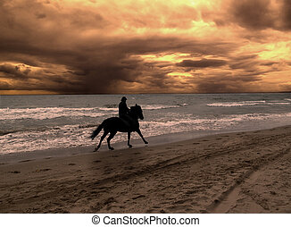 On horseback in dramatic sunset - On horseback in a dramatic...