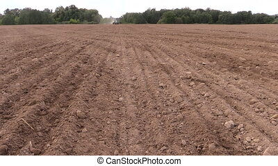 field soil - Soil earth and tractor spread fertilizer on...