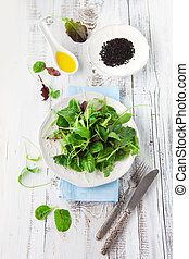 Fresh green salad with spinach, arugula, romaine and lettuce...
