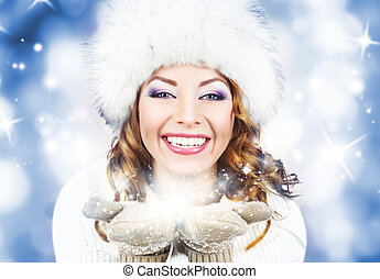 Young and beautiful woman in traditional winter dress over...
