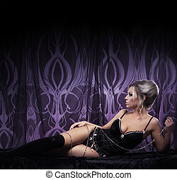 Young attractive woman in sexy lingerie posing in luxury interior