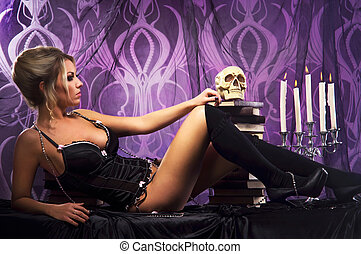 Young attractive woman in sexy lingerie posing in gothic...
