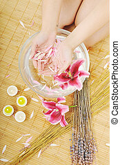 hand spa and beauty treatment with aroma and flowers in...