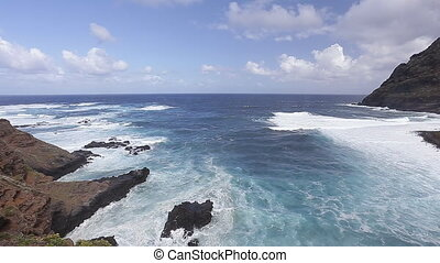 Wild waves clashing on vulcanic rocks of Tenerife spain
