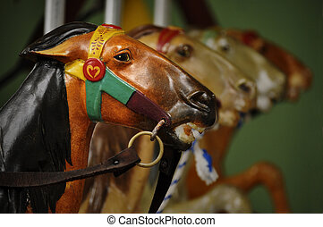 Closeup of merry-go-round - Closeup of horses on a...