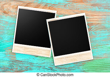 old photo frames over rustic wooden background - old photo...