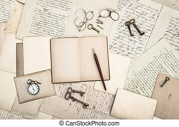 open book, vintage accessories, old letters and postcards....