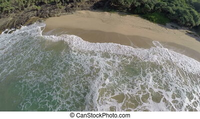 flying over sea waves on tropical beach