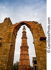 Archway framing the Qutub Minar in Delhi - Archway framing...