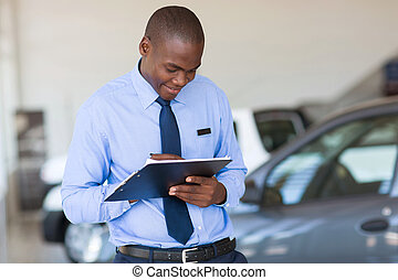 african american man working at vehicle showroom