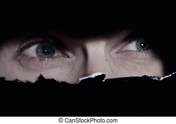 Scary eyes of a man spying