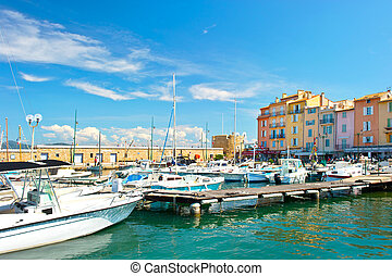 mediterranean landscape with boats and old buildings in...