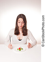 Radical diet - Portrait of a frustrated looking young...