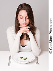 Shock diet. - Portrait of gorgeous young brunette with diet...