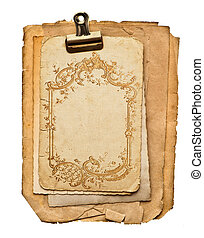 old blank paper sheets with golden ornament