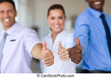 business team giving thumbs up - close up portrait of...