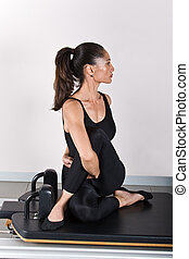 Gymnastics pilates - Spine twist and arms exercise. Pilates...
