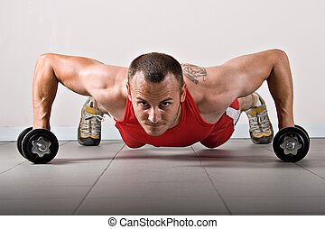 Fitness training - Push up with dumbbells, classic endurance...