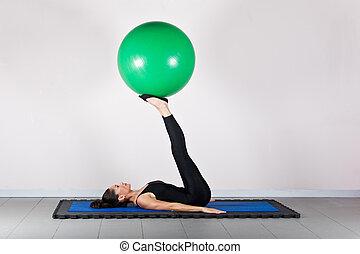 Gymnastics pilates - Balance exercise.Pilates gymnastics is...