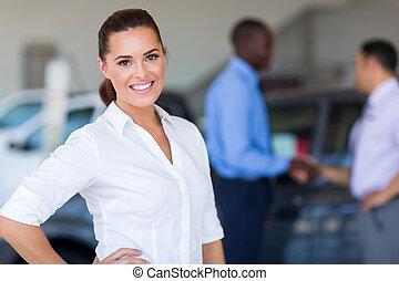 female car dealer inside showroom - pretty female car dealer...