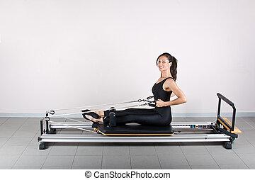 Gymnastics pilates - Rowing exercise.Pilates gymnastics is a...