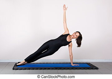 Gymnastics pilates - T shape exercise.Pilates gymnastics is...