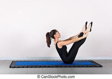 Gymnastics pilates - Teaser exercise. Pilates gymnastics is...