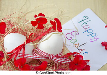 Happy Easter card - Two white eggs with ribbons attached...
