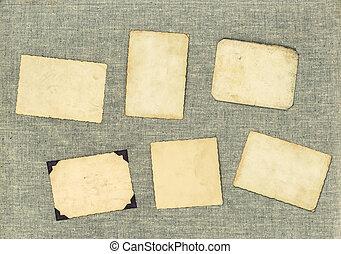 vintage photo frames over textile background. aged paper
