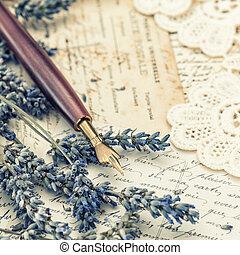 vintage ink pen, dried lavender flowers and old love...