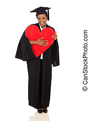 african university graduate holding red heart